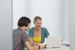 Smiling Women Using Laptop In Office Royalty Free Stock Photo