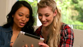 Smiling women using tablet stock footage