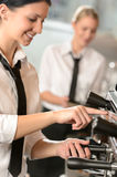 Smiling women waitress preparing coffee machine Stock Image