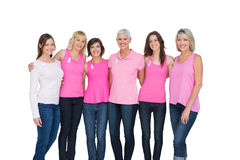 Smiling women wearing pink for breast cancer awareness Royalty Free Stock Image