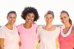 Smiling women wearing pink for breast cancer Stock Image