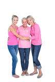 Smiling women wearing pink tops and ribbons for breast cancer Stock Photography