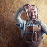 Smiling wood worker. With apron royalty free stock images