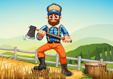 A smiling woodman holding an axe Royalty Free Stock Images