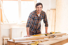 Smiling woodworker. Stock Photo