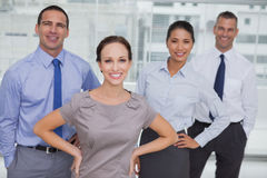 Smiling work team posing together looking at camera Royalty Free Stock Photo