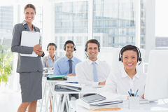 Smiling work team using computer Stock Image