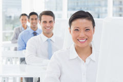 Smiling work team using computer Royalty Free Stock Image