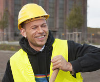 Smiling worker. Smiling construction worker in yellow hard hat Royalty Free Stock Photography