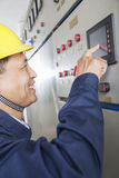 Smiling worker checking controls in a gas plant, Beijing, China royalty free stock images