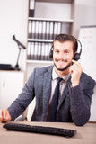 Smiling worker from Customer service support in the office Stock Photography