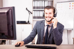 Smiling worker from Customer service support in the office Royalty Free Stock Photography