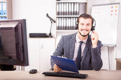 Smiling worker from Customer service support in the office Stock Image