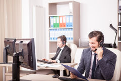 Smiling worker from Customer service support in the office Stock Photo