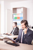 Smiling worker from Customer service support in the office Royalty Free Stock Photos