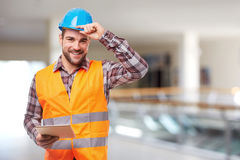 Smiling worker with digital tablet Royalty Free Stock Image