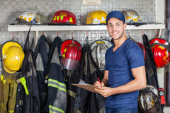 Smiling Worker Holding Clipboard At Fire Station Royalty Free Stock Photo