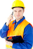 Smiling worker holding a clipboard and phoning Stock Photo