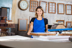 Smiling Worker Holding Mold At Paper Factory Stock Photography