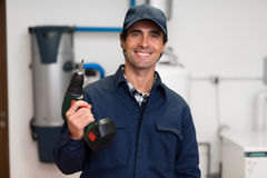 Smiling worker holding a screwdriver Stock Images