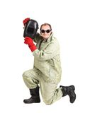 Smiling worker holding welder mask. Stock Photo