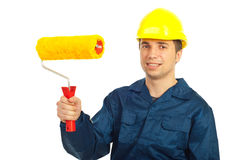 Smiling worker man holding paint roller. Smiling worker man with hard hat holding paint roller isolated on white background royalty free stock photos