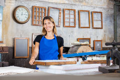 Smiling Worker With Mold At Paper Factory Royalty Free Stock Photos