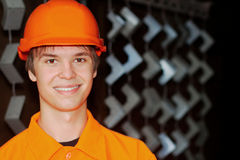 Smiling worker with painted parts on a background Stock Images