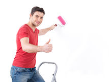 Worker painter with brush  showing thumbs up sign Stock Image