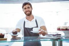 Smiling worker prepares breakfast Royalty Free Stock Images