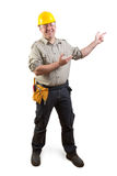 Smiling worker with presenting gesture Royalty Free Stock Images