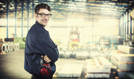 Smiling worker in protective uniform Stock Photography