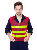 Smiling worker in a reflective vest Stock Photography