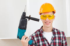 Smiling worker with rock-drill Royalty Free Stock Image