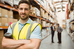 Smiling worker standing with arms crossed Royalty Free Stock Photos