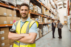 Smiling worker standing with arms crossed Stock Photos