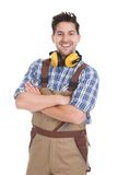Smiling worker standing arms crossed over white background Royalty Free Stock Images