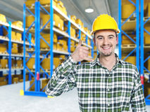 Smiling worker in warehouse. Call me pose Stock Photo