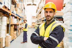Smiling worker wearing yellow vest with arms crossed Royalty Free Stock Photography