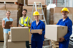 Smiling workers carrying boxes Stock Image