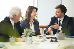 Smiling workers of corporation. Discussing about job Royalty Free Stock Photo
