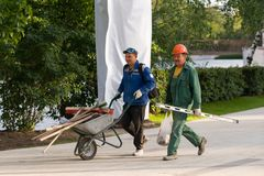 Smiling workers at the end of the day go to take inventory royalty free stock images