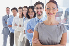 Smiling workers in a line royalty free stock photo