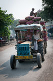 Smiling workers on the overfull tractor, India Royalty Free Stock Image
