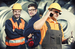 Smiling workers in protective uniforms Stock Photo