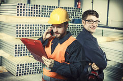 Smiling workers in protective uniforms Stock Image