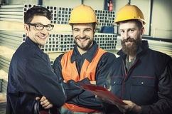 Smiling workers in protective uniforms Stock Photos