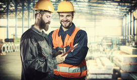 Smiling workers in protective uniforms Stock Photography