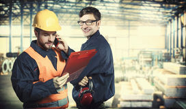 Smiling workers in protective uniforms Royalty Free Stock Photography