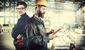 Smiling workers in protective uniforms Royalty Free Stock Photos